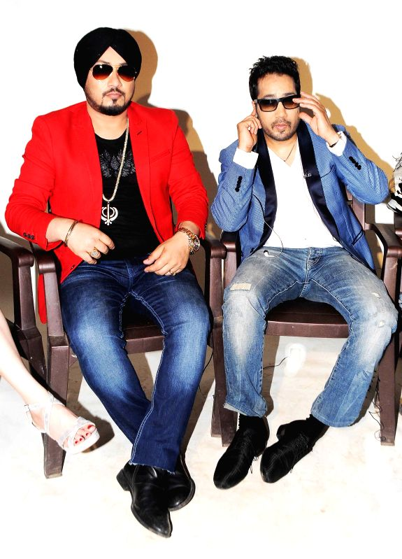 Singer Dilbagh Singh & Mika Singh during photo shoot of album 'BottomsUp' in Mumbai on 24th March 2015. - Dilbagh Singh and Mika Singh