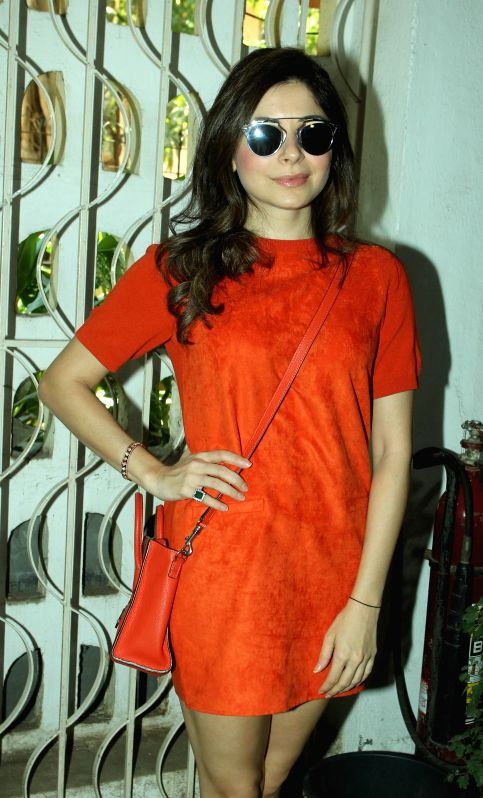 Singer Kanika Kapoor during the unveiling of Society magazine April issue, in Mumbai on March 31, 2015. - Kanika Kapoor