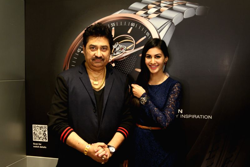 Singer Kumar Sanu and actress Amyra Dastur at Roaymnd Weil store in Mumbai on April 21, 2015.
