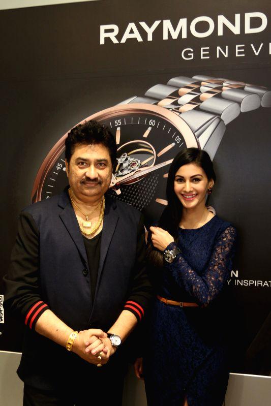 Singer Kumar Sanu and actress Amyra Dastur at Roaymnd Weil store in Mumbai on April 21, 2015.