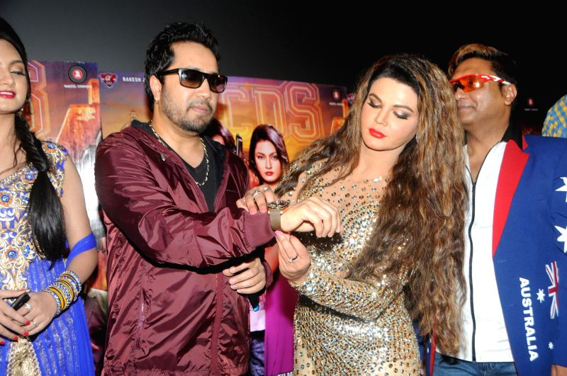 Singer Mika Singh with Rakhi Sawant during the trailer launch of film Mumbai Can Dance Saala in Mumbai, on Dec. 22, 2014. - Mika Singh