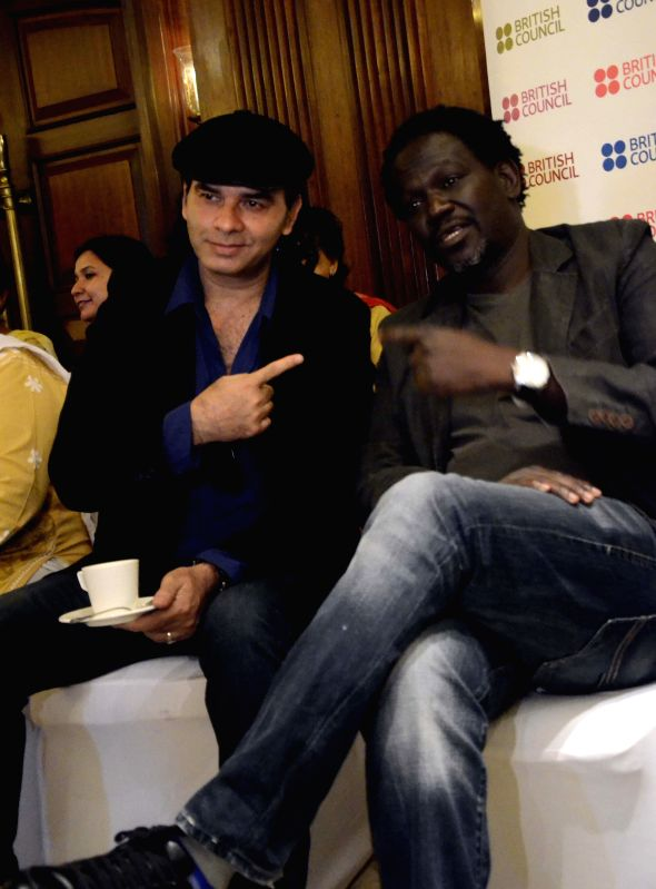 Singer Mohit Chauhan and Senegalese musician Metzo Djatah during a music programme organised by the British Council in Mumbai on March 18, 2015.
