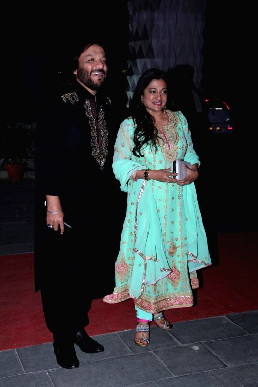 Singer Roop Kumar Rathod with wife Sunali Rathod during the wedding reception of Tulsi Kumar and Hitesh in Mumbai on March 2, 2015. - Roop Kumar Rathod