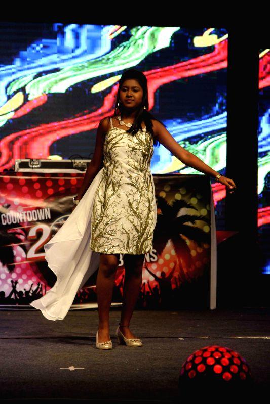 Singer Sanchiti Sakat performs during the new year celebrations in Mumbai, on Dec. 31, 2014.