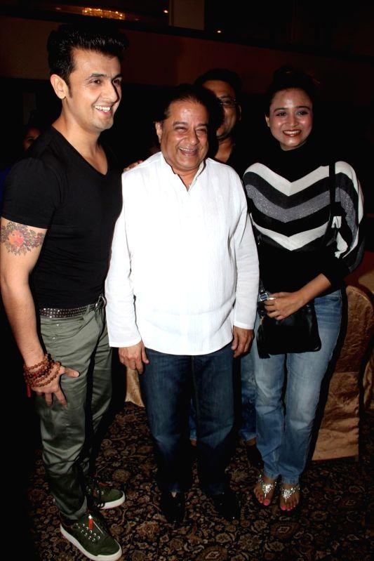 Singer Sonu Nigam and Bhajan singer Anup Jalota during the success of the World Music Symphony in Mumbai on Feb 27, 2015. - Sonu Nigam