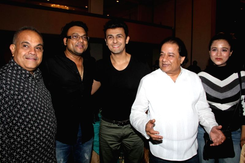 Singer Sonu Nigam and Bhajan singer Anup Jalota during the success of the World Music Symphony in Mumbai on Feb 27, 2015. - Sonu Nigam