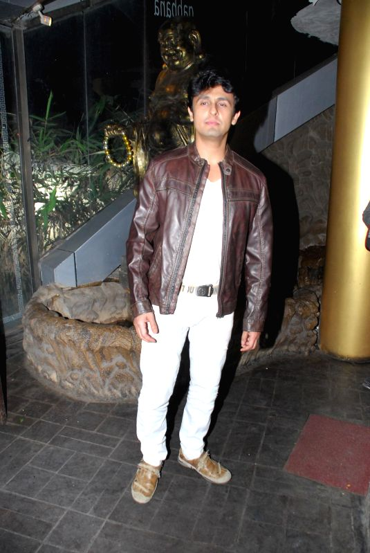 Singer Sonu Nigam during the birthday celebrations of actor Richa Chadda in Mumbai, on Dec. 17, 2014. - Sonu Nigam