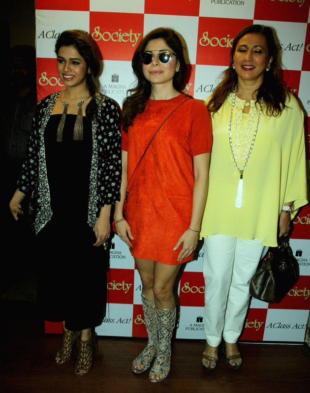 Singers Shalmali Kholgade, Kanika Kapoor and Meera Gandhi, CEO, The Giving Back Foundation, during the unveiling of Society magazine April issue, in Mumbai on March 31, 2015. - Kanika Kapoor and Meera Gandhi