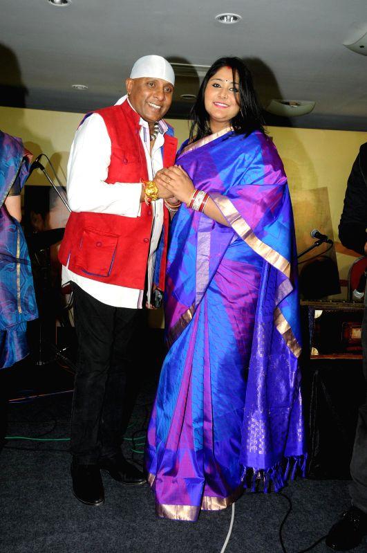 Singers Sivamani and Runa Rizvi during Music Mania Artist of the Year 2014.