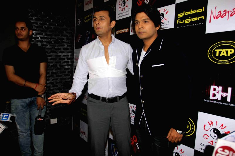Singers Sonu Nigam and Ankit Tiwary during the birthday party in Mumbai on March 5, 2015. - Sonu Nigam