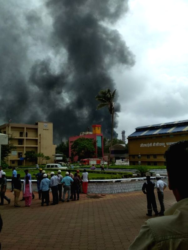 : Mumbai: Smoke comes out after a series of loud explosions followed by a massive fire were reported at a refinery of the Bharat Petroleum Corporation Ltd (BPCL) at Chembur in the eastern suburbs of ...