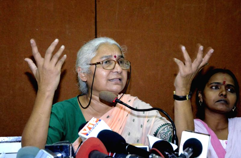 Social activist Medha Patkar addresses a press conference in Mumbai, on Dec 22, 2014.