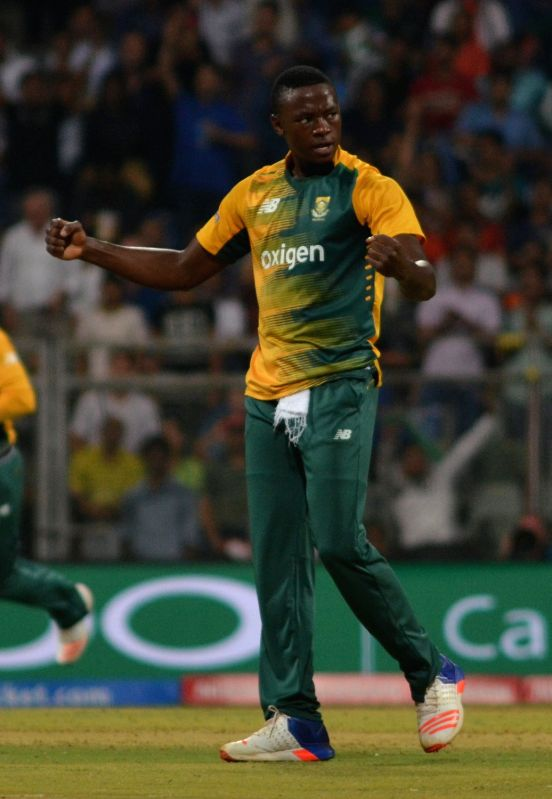 Mumbai: South African bowler Kagiso Rabada celebrates fall of Ben Stokes` wicket during a WT20 match between England and South Africa at Wankhede Stadium in Mumbai on March 18, 2016. (Photo: Nitin Lawate/IANS)