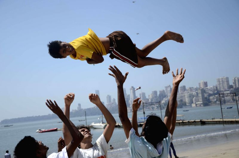 Students during rehearsals for their college programme at Girgaum Chowpatty in Mumbai, on Feb 17, 2015.