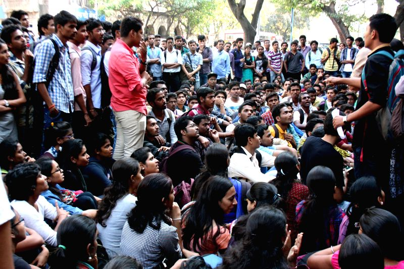 Students of Tasgaonkar Institute protest to start lectures as the non-teaching staff is on strike and is refusing to allow students and teachers to enter the premises at Bhivpuri, Karjat in ..