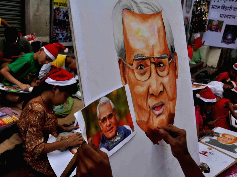 Students participate in a painting competition organised by Gurukul drawing school on the eve of former prime minister Atal Bihari Vajpayee in Mumbai on Dec 24, 2014.