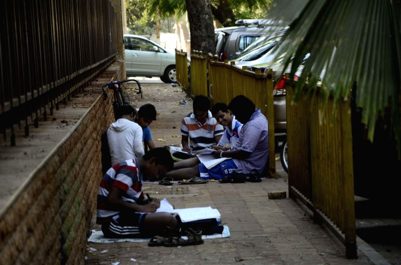Students prepare for their Class X board exams on the pavements of Mumbai on Feb 26, 2015.