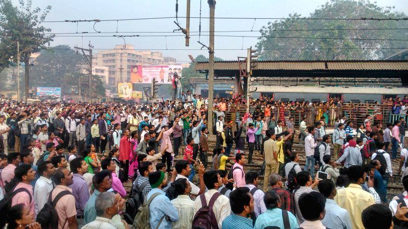 Suburban train commuters stage impromptu agitation as train services were disrupted  during the the morning peak hour in Mumbai, on Jan 2, 2015. The technical hitch and the subsequent ...