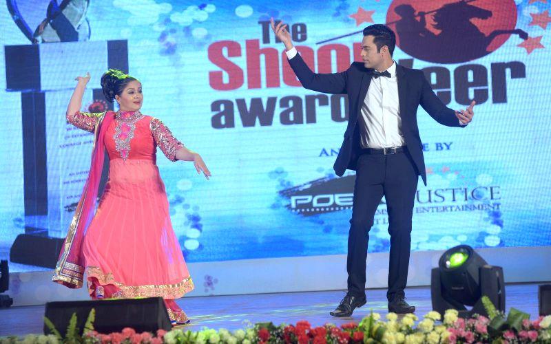 Sudha Chandran and Samir Kochhar performing during the `Shoorveer Awards` in Mumbai on March 15, 2015.