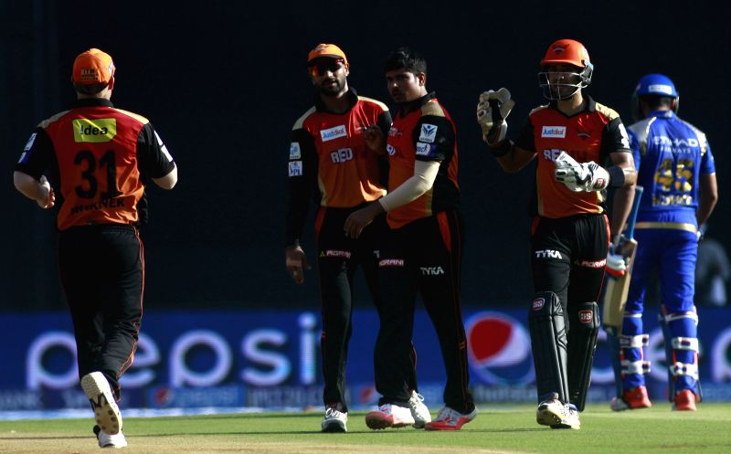 Sunrisers Hyderabad player Karn Sharma celebrates fall of Rohit Sharma`s wicket during an IPL-2015 match between Mumbai Indians and Sunrisers Hyderabad at Wankhede Stadium, in Mumbai, on ... - Karn Sharma and Rohit Sharma