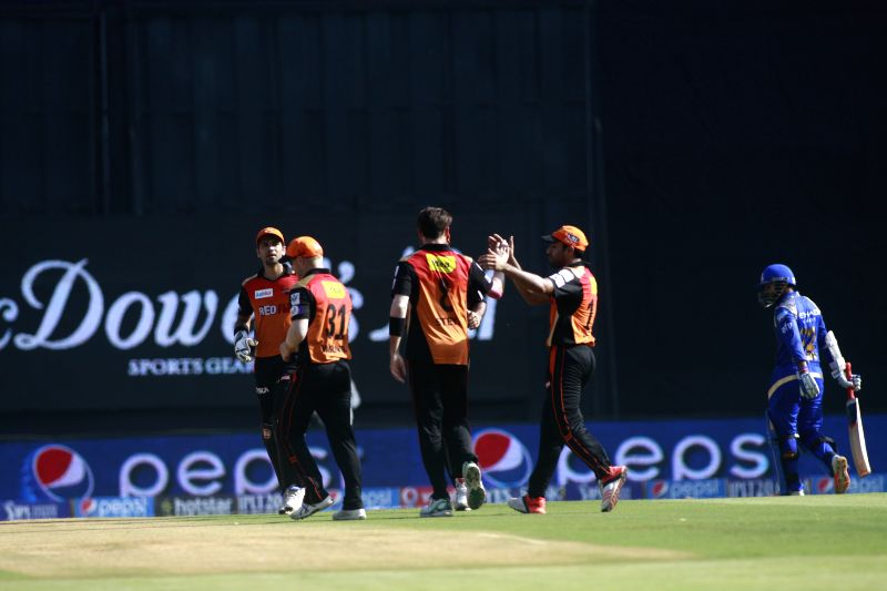 Sunrisers Hyderabad players celebrate fall of a wicket during an IPL-2015 match between Mumbai Indians and Sunrisers Hyderabad at Wankhede Stadium, in Mumbai, on April 25, 2015.