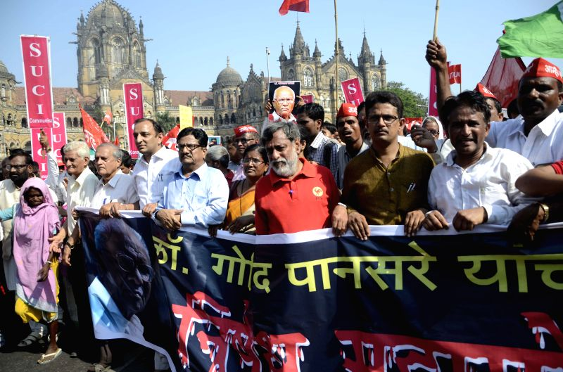 Supporters of CPI veteran Govind Pansare participates in a rally to protest against his murder in Mumbai on March 11, 2015.
