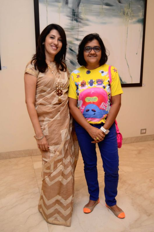 Tarana Khubchandani (L), gallery owner Art and Soul and artist Jeni Bhat during Bollywood actor Amol Palekar's painting exhibition, in Mumbai on Nov 25, 2014. - Jeni Bhat