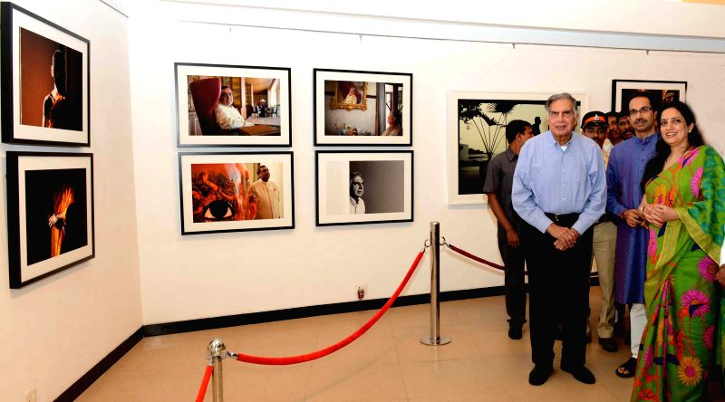 Tata group Chairman Emeritus Ratan Tata with Shiv Sena Chief Uddhav Thackeray at his photography exhibition organised to raise funds for drought affected farmers, in Mumbai, on Jan 12, 2015. - Ratan Tata