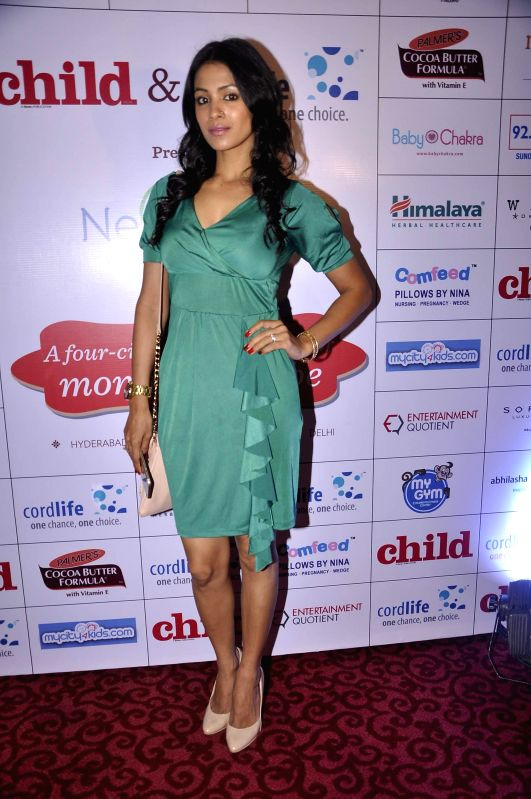 Television actor Barkha Bisht during a expecting mothers fashion show organised by Cordlife in Mumbai on March 15, 2015. - Barkha Bisht