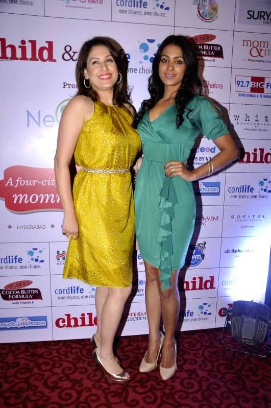 Television actors Barkha Bisht and Amrita Raichand during a expecting mothers fashion show organised by Cordlife in Mumbai on March 15, 2015. - Barkha Bisht and Amrita Raichand