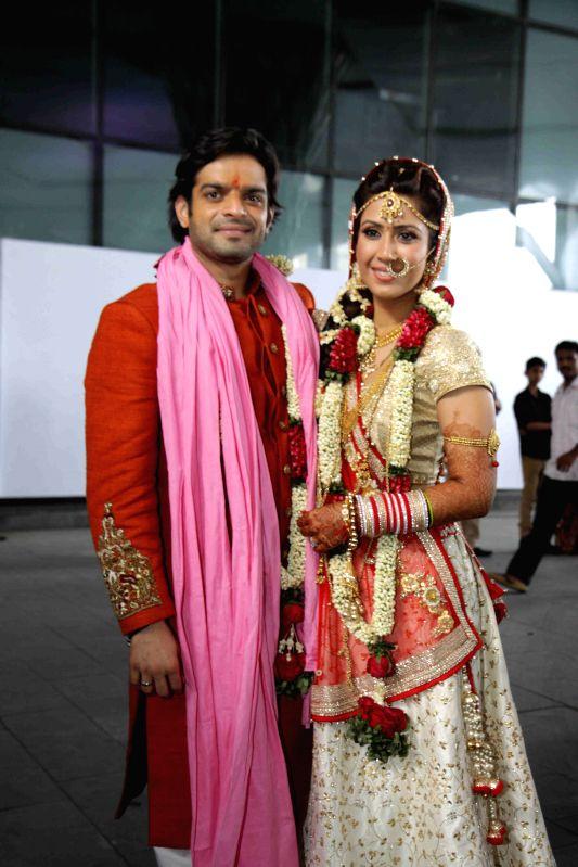 Television actors Karan Patel and Ankita Bhargava pose after their wedding in Mumbai on May 3, 2015.
