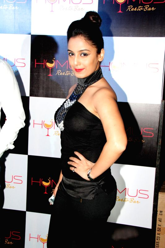 Television actors Manish Naggdev and Srishty Rode during Hymus Resto bar launch in Mumbai, on Dec. 12, 2014. - Manish Naggdev and Srishty Rode