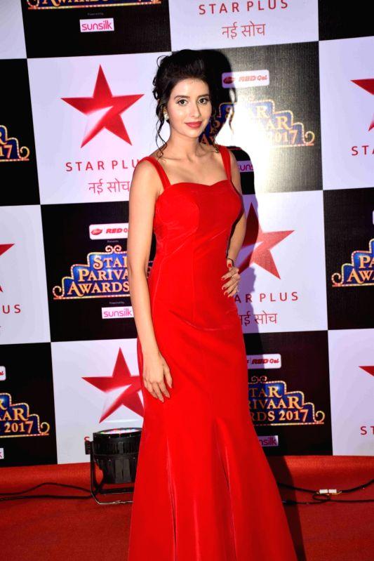 :Mumbai: Television actress Charu Asopa during the red carpet of Star Parivaar Awards 2017 in Mumbai on May 13, 2017. (Photo: IANS).