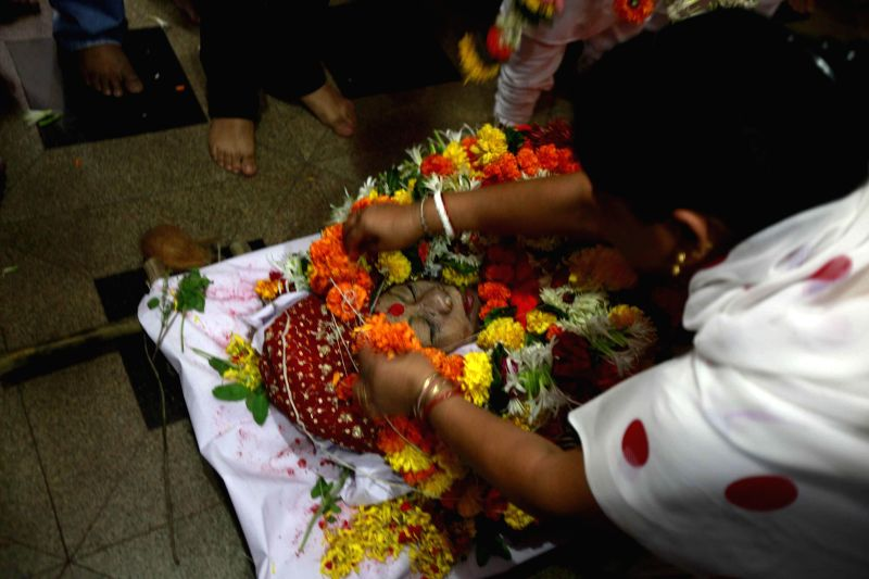 The body of eminent Kathak danseuse Sitara Devi, who died Tuesday (25th Nov, 2014) at her funeral in Mumbai on Nov 27, 2014.