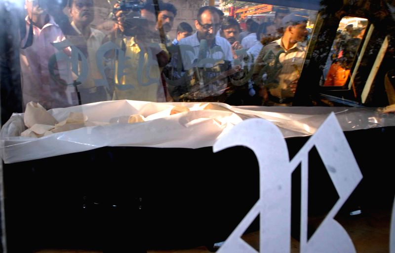 The body of the Communist leader Govind Pansare being taken away after postmortem from J J Hospital to his home town Kolhapur by air ambulance in Mumbai on Feb 21, 2015. Veteran Left leader ...