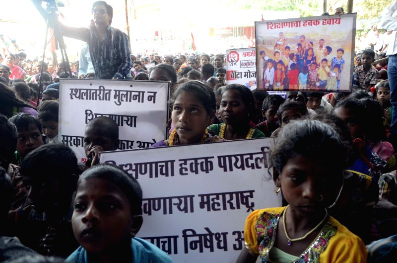 The children of brick kiln workers stage a demonstration to press for their right to education at Azad maidan in Mumbai on March 30, 2015.