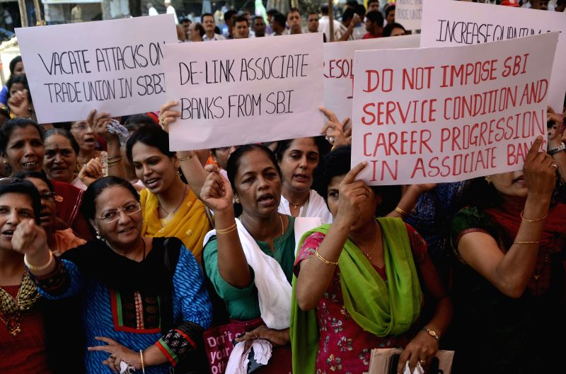 The employees of associate banks of the State Bank of India stage a demonstration against imposition of SBI service conditions on them at Azad Maidan in Mumbai, on June 4, 2015.