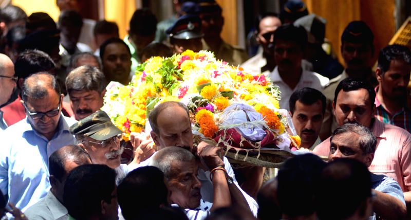 The last rites of Senior Police Inspector Vilas Joshi, who succumbed to his injuries after being shot at by his subordinate, underway in Mumbai, on May 3, 2015.