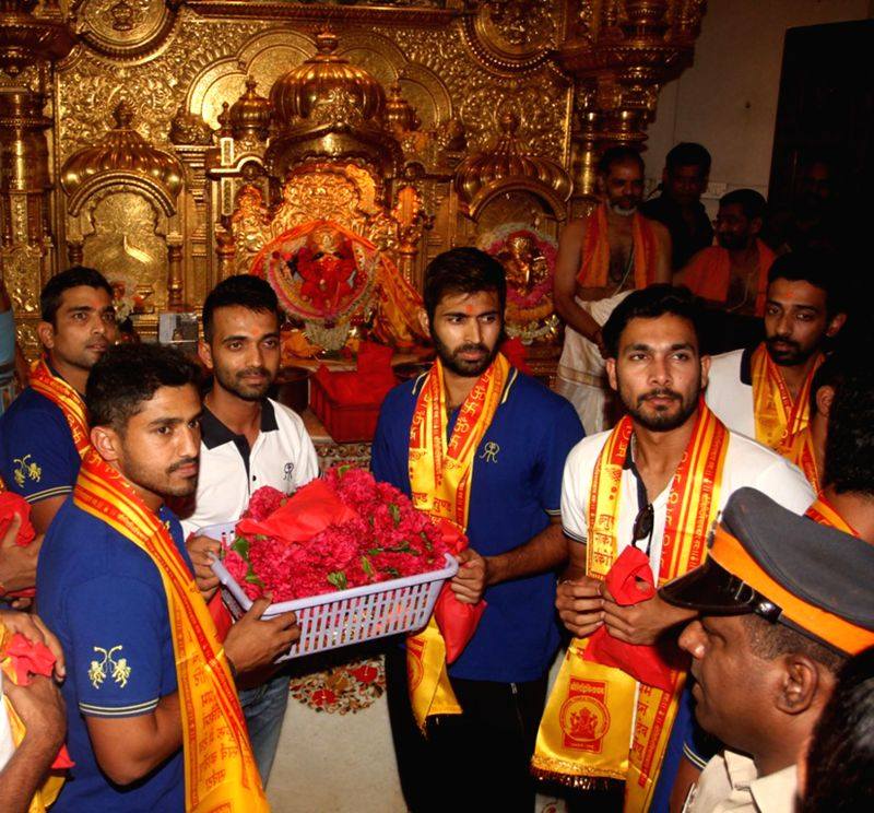 The Rajasthan Royals players led by Ajinkya Rahane pay obeisance at the Siddhivinayak Temple in Mumbai, on April 30, 2015.