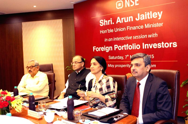 The Union Minister for Finance, Corporate Affairs, and Information and Broadcasting Arun Jaitley addresses during an interactive session with the Foreign Portfolio Investors, in Mumbai on ...