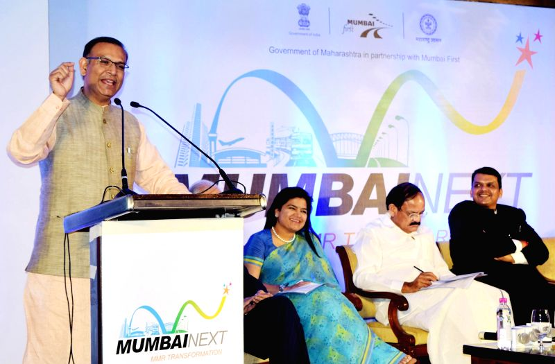 The Union Minister of State for Finance Jayant Sinha addresses at the `Mumbai Next` summit, in Mumbai on Feb 6, 2015. Also seen the Union Minister for Urban Development, Housing and Urban ... - Devendra Fadnavis and M. Venkaiah Naidu