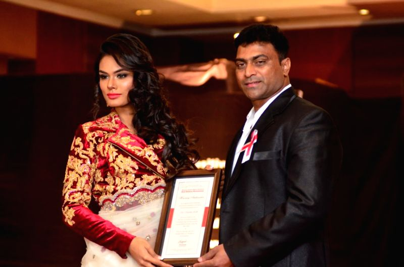 The winner of Fascino Miss Diva Universe 2014, Noyonita Lodh, who was appointed as the ambassador of Red Ribbon Revolution, during a programme organised on World AIDS Day in Mumbai ..
