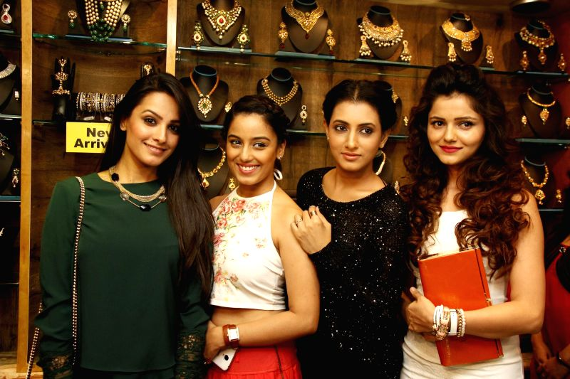 TV celebs during the announcement of Telly Calendar 2015 girls on the 19th Anniversary of Sia Art Jewellery store in Mumbai on Thursday, Dec 11, 2014.
