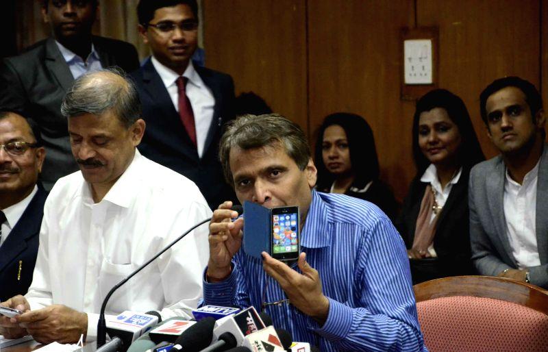 Union Minister for Railways Suresh Prabhakar Prabhu addresses at the launch of a mobile app for women safety in Mumbai on Jan 9, 2015. - Suresh Prabhakar Prabhu