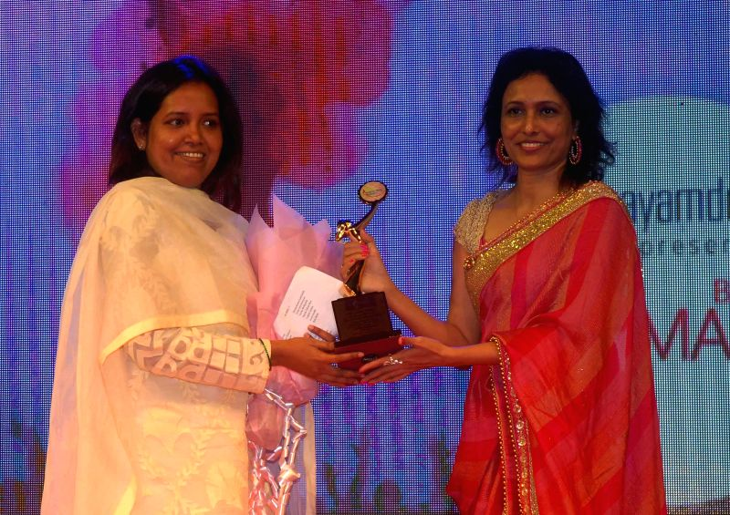 Varsha Gaikwadand Organiser Dr. Bhavna Raj during the `Being Woman`, a special event on International woman`s day, in Mumbai, on March 8, 2015.
