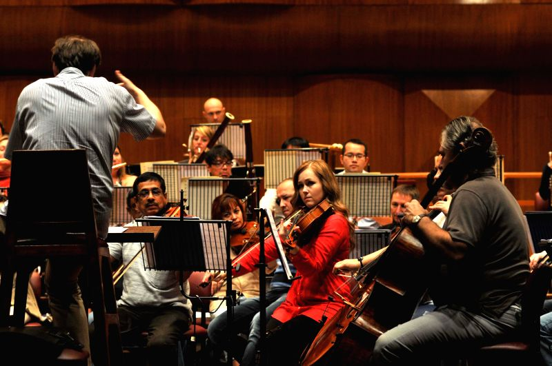 Violinists perfom at the18th season of the Symphony Orchestra of India (SOI) at NCPA in Mumbai on Feb. 3, 2015.
