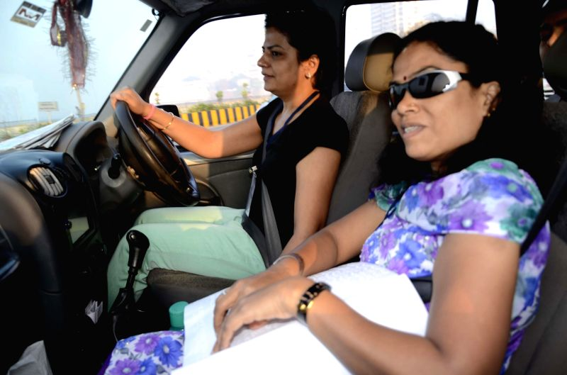 Visually handicapped people participate in a Blind Car Rally in Worli, Mumbai on Feb 8, 2015.