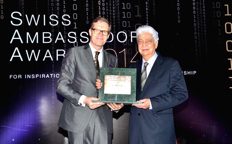 Wipro Chairman Azim Premji receives the Swiss Ambassador's Award from Swiss Ambassador to India Dr. Linus von Castelmur in Mumbai, on Dec 3, 2014.