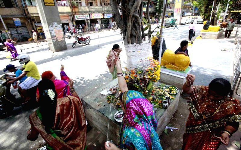 Women perform rituals on Vat Purnima in Mumbai, on June 2, 2015.