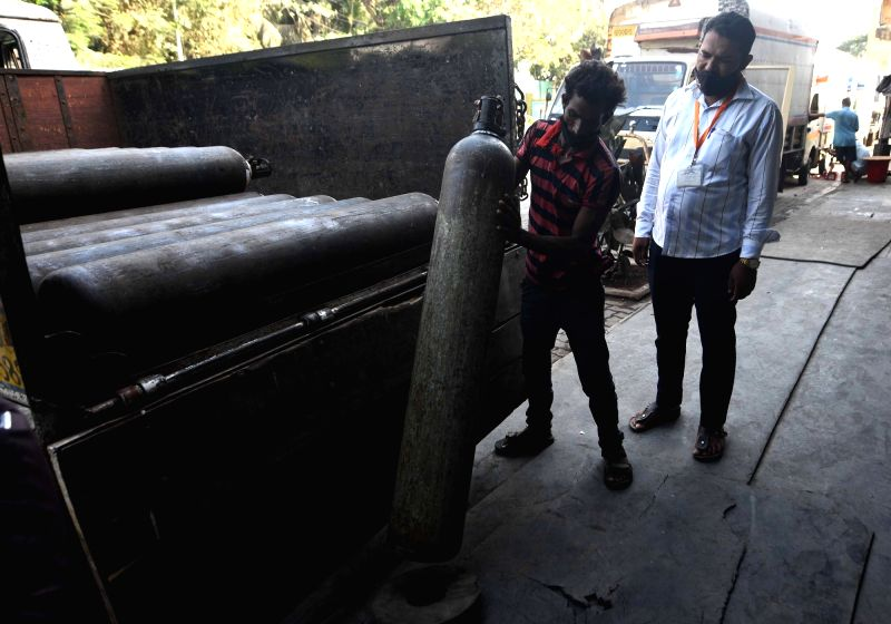 Mumbai: Workers load medical oxygen cylinders for hospital use on Covid-19 coronavirus patients amid the rising cases in Mumbai, on Monday April 19, 2021. Pic:- Sandeep Mahankal